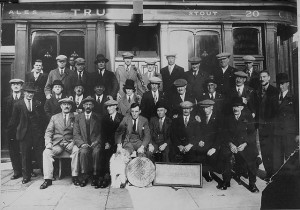 """""""Hope and Anchor dart club"""", Hope and Anchor, 20 Waterloo Street (now Macbeth Street), Hammersmith, London, UK. ca 1925. NB publican Charles Fletcher (seated front row center) with elm board"""